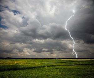 Lightning blot striking in a field