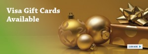 Present and Christmas ornaments on a gold background with text that reads visa gift cards now available