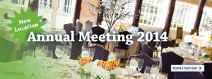 Elegant place settings at a nice dinner. Text talks about annual meeting
