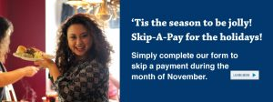 Woman with dark curly hair is holding a plate of food and smiling. The wording talks about the skip-a-pay promotion.