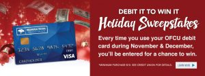 Debit card with a festive holiday background. The words talk about the holiday sweepstakes promotion.