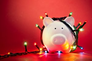 Piggy bank wrapped in Christmas lights